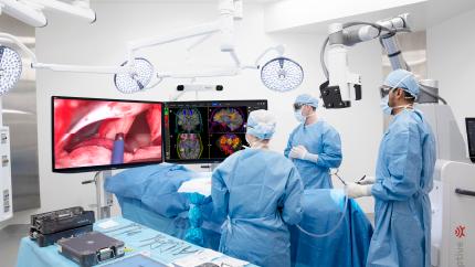 surgeons operating and looking at monitors