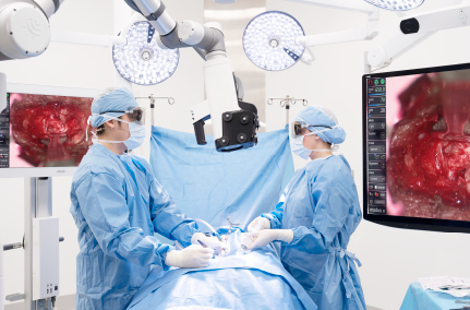 surgeons performing spine surgery
