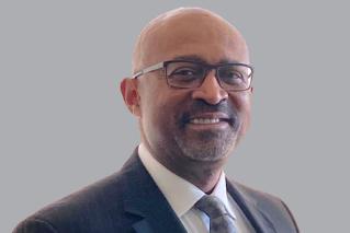 Man smiling in suit