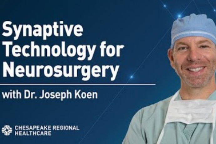 surgeon in front of blue background